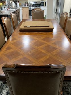 Hard Solid Wood Dining Table With One Leaf And 8 Real Leather Chairs Excellent Condition High Quality Table for Sale in Las Vegas,  NV