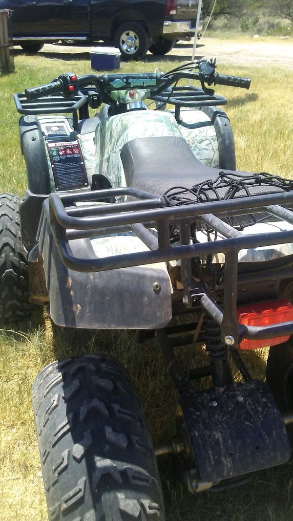 Tao Tao atv. Only 4 months old but have to sell because Wife is scared of it. 200cc plenty of power. Has a 4500lb winch. Will sell for 1000 dolla