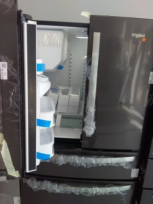 Whirlpool 4 doors stainless steel refrigerator new scratch and dents good condition 6 months warranty for Sale in Mount Rainier, MD