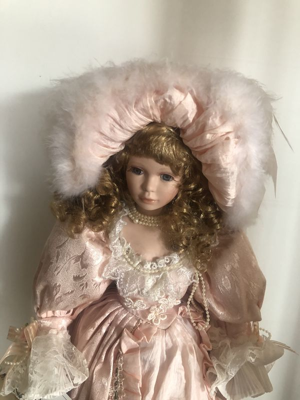 Elegant Porcelain Doll in gown and parasol.