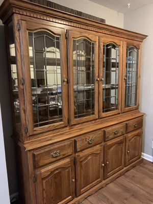 Illuminated Solid oak buffet server and hutch with antique goldstone hardware for Sale in Lexington, KY