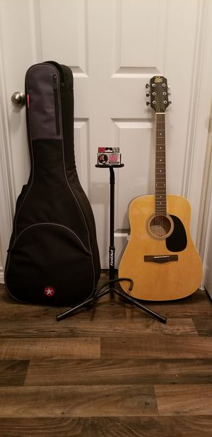 Acustic Guitar Rogue, Swing Wall Guitar Holder, Clip on Tuner, Gig Bag and Guitar Stand for Sale in Mesquite, TX