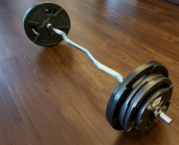 Curl bar with 100lbs weight set