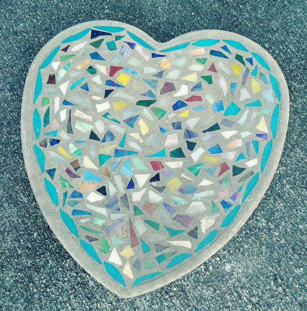 Heart shaped mosaic garden stone