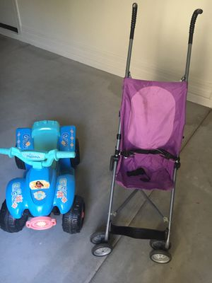 Moana riding car and stroller $8 for Sale in Queen Creek, AZ