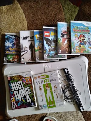 Wii games, Wii board and a sensor. for Sale in Seattle, WA