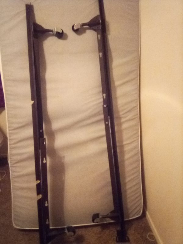 Metal Bedframe with wheels Twin/Full