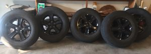 """5 18"""" factory black Jeep wheels with like new tires for Sale in Fort Worth, TX"""