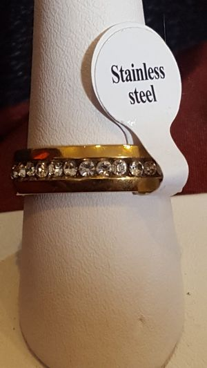 Sizes 6, 7, 10, 11 and 12 available. Brand new gold stainless steel wedding rings for Sale in St. Louis, MO