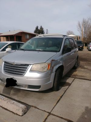 2010 Dodge Caravan for sale runs and drives has 200000 miles and need cosmetics work for Sale in Aurora, CO