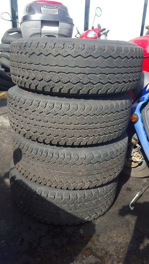 JEEP WRANGLER TJ 96 -06 WHEELS AMD TIRES DUNLOP ALSO TRANSMISION 4 CYL 2.5 AUTO FROM 2000 TJ AND TRANFER CASE 75.500 MILES for Sale in Miami Beach, FL