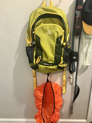 Camel Backpack lime green with Orange Rain cover for Sale in Austin, TX