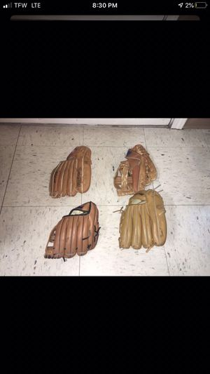 4 slightly used Kids Baseball gloves (2 Left handed 2 Right handed )$8 apiece all for $25 for Sale in Nether Providence Township, PA