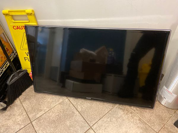 Samsung 42 inch TV with a mounting hardware.