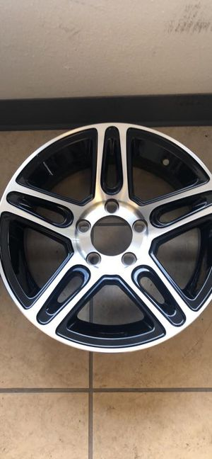 "Boat Trailer rim and tire - aluminum 14"" 5 lug - with 205/75/14 radial tire - comes with center cap and lugs - 14"" 5 lug trailer tires - aluminum for Sale in Plant City, FL"