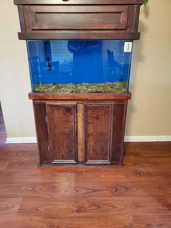 Aquarium for Sale! 65 gallon wood finished aquarium including aquarium filter and accessories.