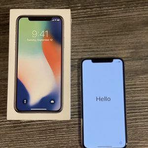 Unlocked iPhone X 64g Silver and Recently Replaced Through AppleCare With Box And New Headphones for Sale in Seattle, WA