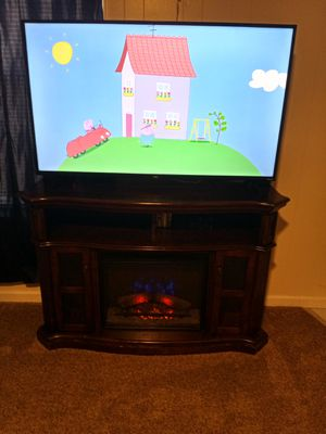 FIREPLACE TV STAND AND 55 INCH TCL SMART FLAT SCREEN TV for Sale in Belton, SC
