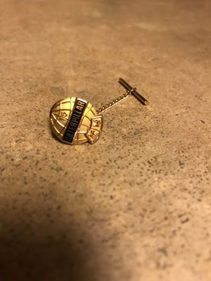 10 Karat Yellow Gold Tie-Pin. Caterpillar Logo. Never Used. Has two very small Gems at Bottom. The back piece is not real gold. Pickup in East Clayto for Sale in Clayton, NC