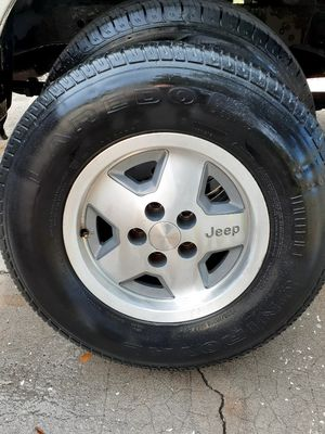Jeep Wrangler yj rims and tires for Sale in Tampa, FL