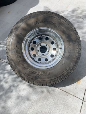 31 x 10.50 15 Bridgestone all terrain tire on chrome 5x4.5 rim for Sale in Aurora, CO
