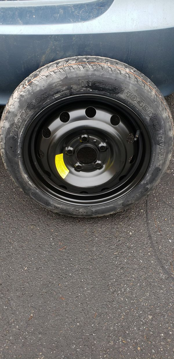 NEW donut rim and tire