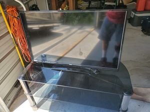 Tv stand and tv for Sale in Morgantown, WV