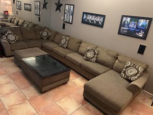 Ashley sectional with extra loveseat and coffee table with storage. for Sale in Cathedral City, CA
