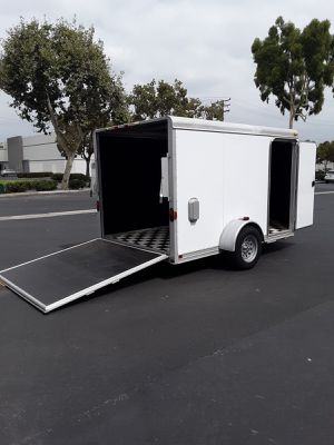 Aluminum Featherlite. enclosed trailer 1 axle also I side door with a rear loading ramp for Sale in CTY OF CMMRCE, CA