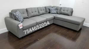 Grey sectional sofa with reversible chaise side 110 x 79 new for Sale in Boca Raton, FL