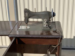 Antique White Rotary Sewing Machine & Beautiful Dark Wood Cabinet for Sale in Biola, CA