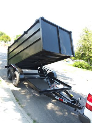 BRAND NEW DUMP TRAILER8X12X4 HEAVY DUTY, ELECTRIC BRAKES, LIGHTS, HYDRAULIC SYSTEM, REMOTE CONTROL,12000 LBS WITH TITLE IN HAND for Sale in Los Angeles, CA