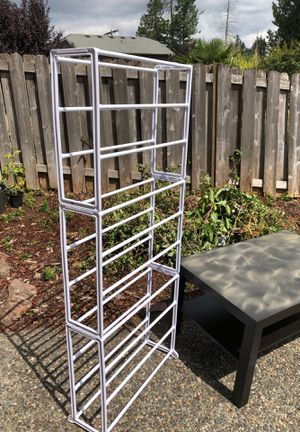 Free stuff. 30 shoe rack/stand, Ikea coffee table (sturdy but needs paint on top...let the kids do it for the game room), hose holder, large pet bed, for Sale in Lynnwood, WA