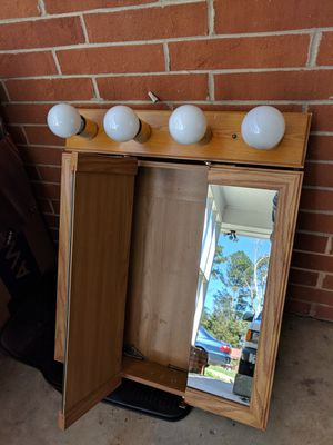 Medicine cabinet and light fixture for Sale in Durham, NC