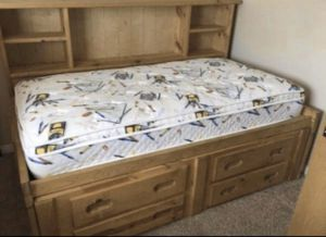 Wooden Twin and bookshelves bed with extra storage dressers all in one included for Sale in Riverside, CA
