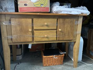 Wooden versatile kitchen or living room table with drawers and cabinet compartments for Sale in Denver, CO