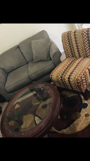 """Living room set sofa with chair and coffee table with 5x7"""" rug in excellent condition smoke pet free home still available for pick up for Sale in Gaithersburg, MD"""
