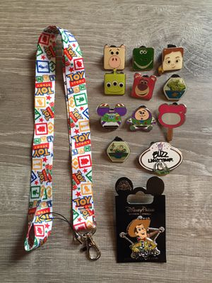 Disney Toy Story lanyard with 12 tradable pins for Sale in Orlando, FL