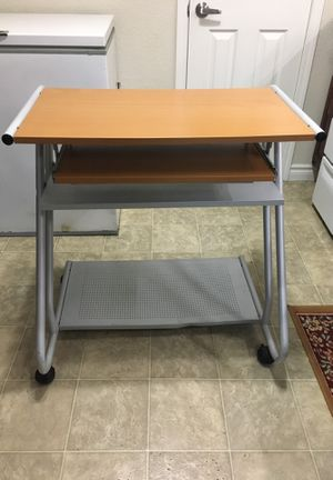 COMPUTER DESK WITH SLIDING KEYBOARD AND ROLLING WHEELS for Sale in Las Vegas, NV