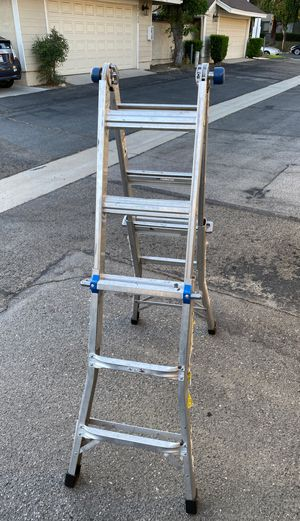WERNER 14 ft. Reach Aluminum Telescoping Multi-Position Ladder with 300 lbs. Load Capacity Type IA Duty Rating for Sale in Ontario, CA