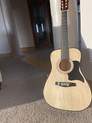 Kids acoustic guitar with new strings for Sale in Puyallup, WA