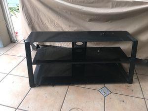 TV stand black glass 4' w /3 division. for Sale in Miami, FL
