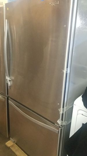 Whirlpool stainless steel top and Battom refrigerator brand new scratch and dent 6 months warranty for Sale in Baltimore, MD