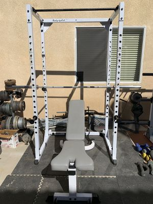 Body solid squat rack, weights plates, bar, bench and clips for Sale in Hemet, CA