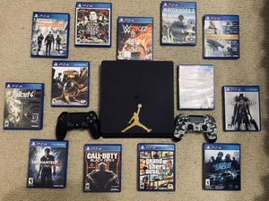 PS4 w/ 2 controllers & charger + 13 games for Sale in La Vergne, TN