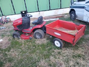 Riding mower with a little pull trailer for Sale in TIMBERCRK CYN, TX