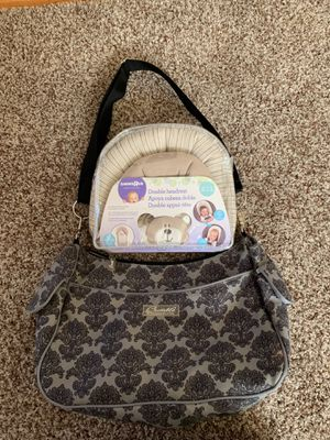 New double baby headrest and used bumble diaper bag for Sale in North Massapequa, NY