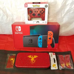 Nintendo Switch + Wireless Controller + Charizard Case / Red Joy Con Skins/ Dust Cloth + Choice of one new game - $460 for Sale in Roseville, CA