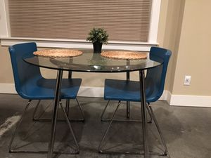 Round glass dining table for two with blue leather chairs for Sale in Seattle, WA