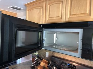 Whirlpool 2.1 cu. ft. Over-the-Range Microwave with Steam cooking - Black Stainless Steel for Sale in HUNTINGTN BCH, CA